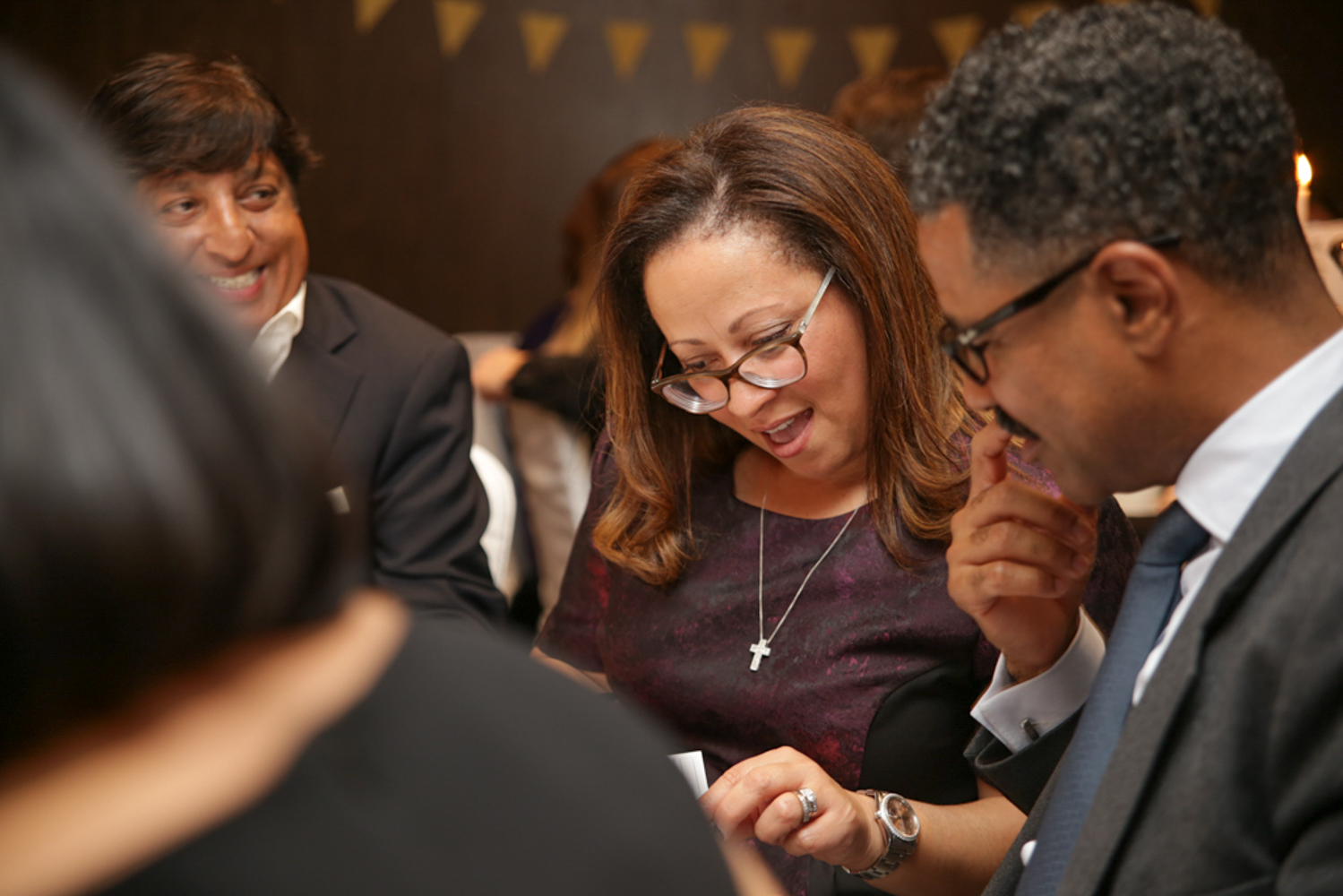 Woman showing document to men at corporate event