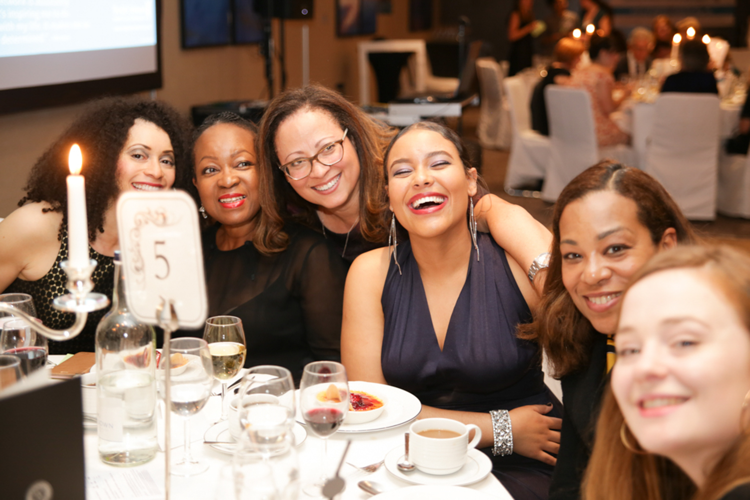 women sitting at a table at corporate event
